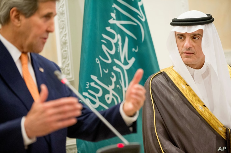 U.S. Secretary of State John Kerry, left, and Saudi Foreign Minister Adel al-Jubeir, right, hold a joint news conference at Riyadh Air Base in Saudi Arabia, Thursday, May 7, 2015.