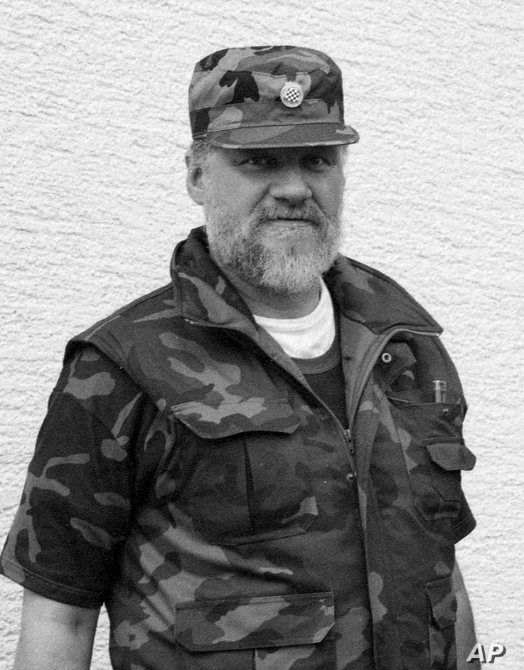 In this September 1991 photo, Slobodan Praljak poses near a front line in Sunja, Croatia. Praljak stunned the International Criminal Tribunal for the former Yugoslavia on Nov. 29, 2017, when he gulped down liquid from a small bottle seconds after a U...
