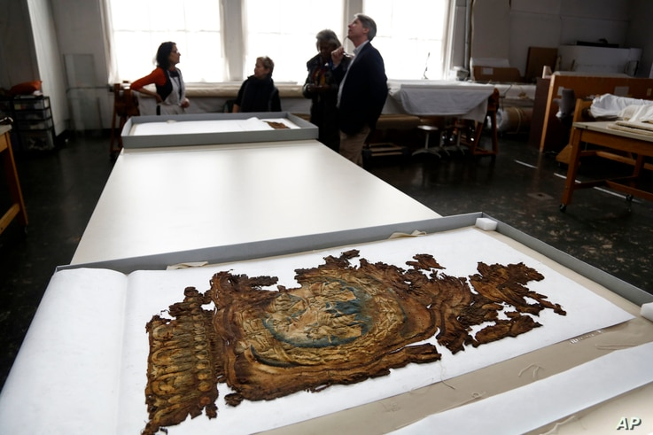 A fragment of a Barberini tapestry that was damaged in a 2001 fire is carefully preserved at the Textile Conservation Laboratory at the Cathedral of St. John the Divine in New York, March 22, 2017.