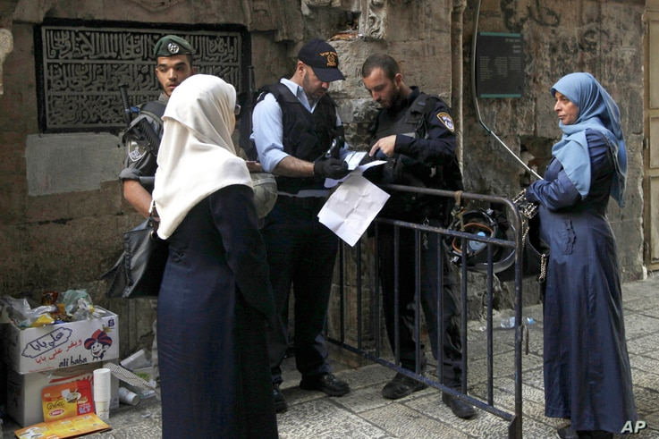 Israeli police check the papers of a Palestinian woman in Jerusalem's Old City, Oct. 8, 2015. Tensions have gripped the country for weeks.