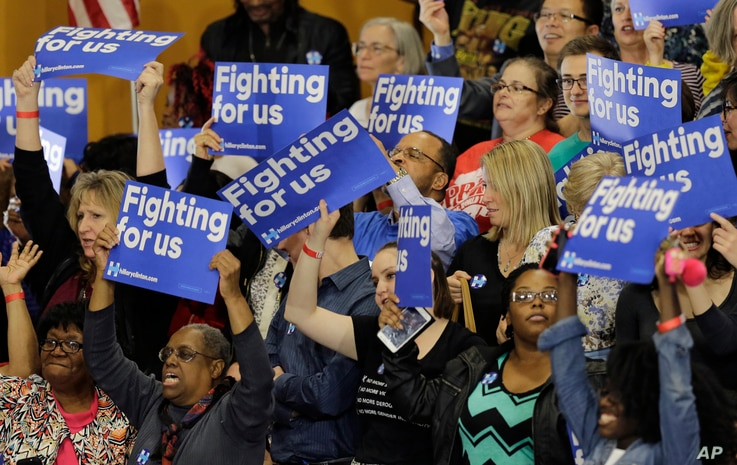 Supporters react to positive primary results for Democratic presidential candidate Hillary Clinton before a rally at Cuyahoga Community College in Cleveland, March 8, 2016.