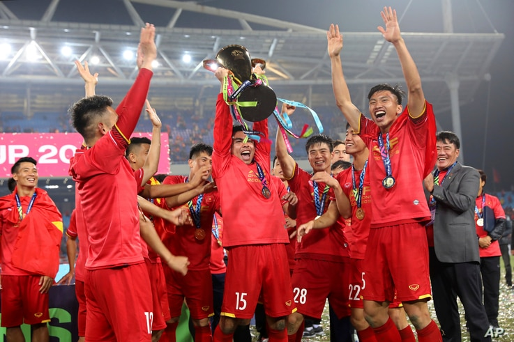 Vietnam's soccer team celebrates after defeating Malaysia at the AFF Suzuki Cup final match between Vietnam and Malaysia at My Dinh stadium in Hanoi, Vietnam on Saturday, Dec. 15, 2018.