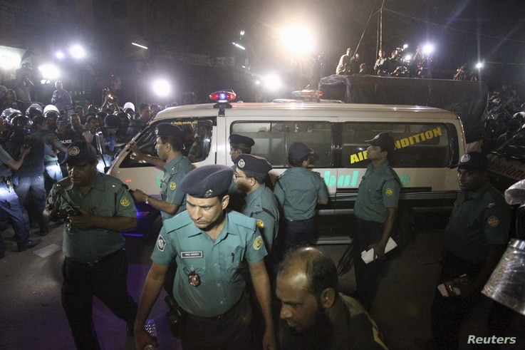 An ambulance carrying the body of Salauddin Quader Chowdhury, a leader of the Bangladesh Nationalist Party, leaves the Dhaka Central Jail after his execution, Nov. 22, 2015.