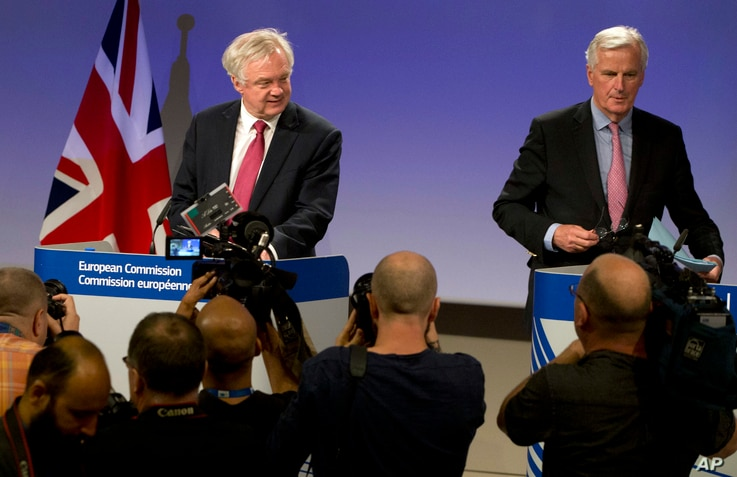 FILE - EU Chief Brexit Negotiator Michel Barnier, right, and British Secretary of State for Exiting the EU David Davis arrive for a media conference at EU headquarters in Brussels, June 19, 2017.
