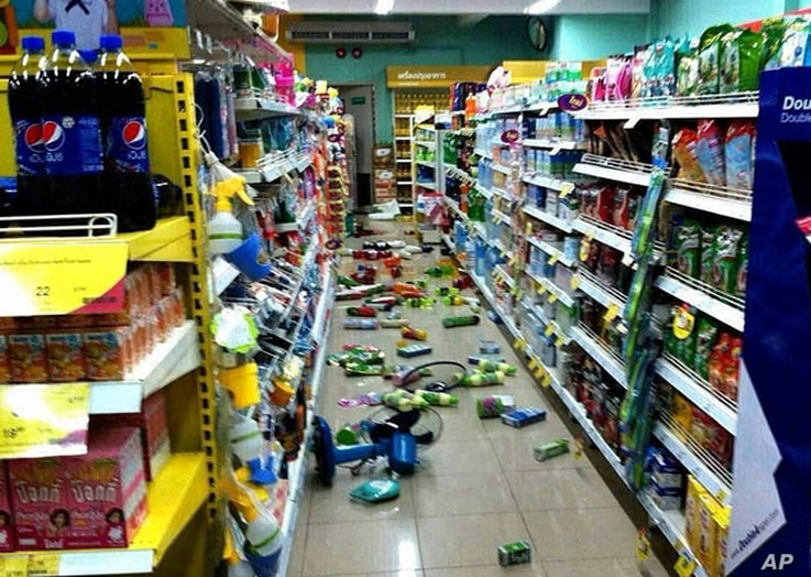 Goods at a grocery store that have fallen from shelves litter the floor after an earthquake in Chiang Rai province, northern Thailand, on May 5, 2014.
