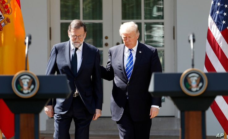 President Donald Trump arrives for a news conference with Spanish Prime Minister Mariano Rajoy in the Rose Garden of the White House in Washington, Sept. 26, 2017.