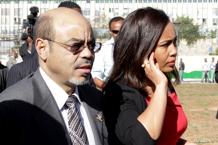 Zenawi arrives with his wife Azeb Mesfi for the 18th African Union Summit in Addis Ababa, Jan. 29, 2012.