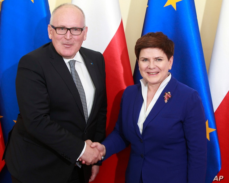FILE - Poland's Prime Minister Beata Szydlo, right, and EU Commission Vice President Frans Timmermans before talks on ways of ending Poland's political conflict that has strained ties with Brussels, in Warsaw, Poland, May 24, 2016.