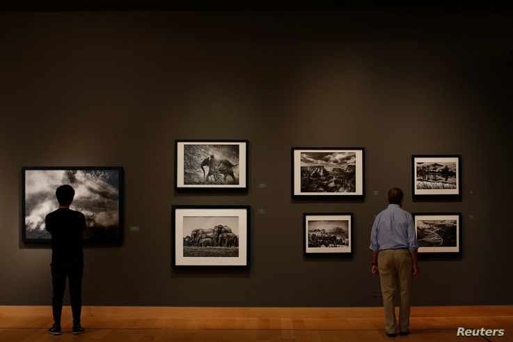 People attend an exhibition of Brazilian photographer Sebastiao Salgado titled 'The World Through His Eyes' at the Bangkok Art and Culture Center in Bangkok, Thailand, Feb. 10, 2017.