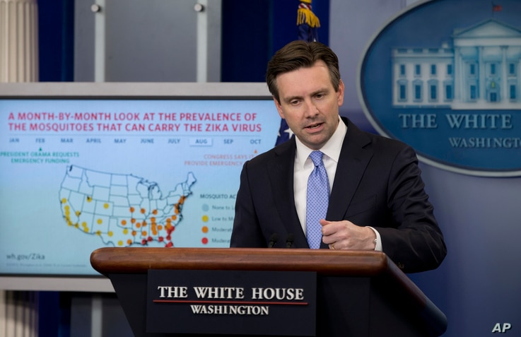 FILE - White House press secretary Josh Earnest discusses Zika virus during the daily news briefing at the White House in Washington.