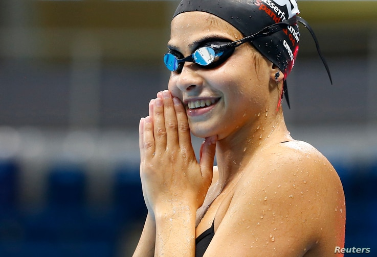 Syrian refugee team swimmer Yusra Mardini, 18, from Syria practices at the Olympic swimming venue.