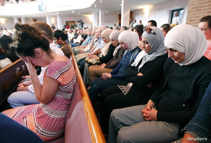 People from different faiths pray during an interfaith vigil for the victims of the Tennessee shooting, at Olivet Baptist church in Chattanooga, Tennessee, July 17, 2015.