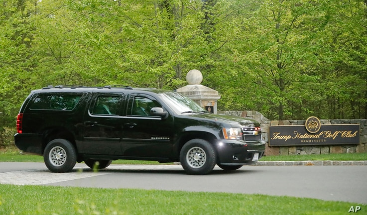 FILE - A motorcade SUV vehicle transporting President Donald Trump leaves the Trump National Golf Club in Bedminster, N.J., May 7, 2017.