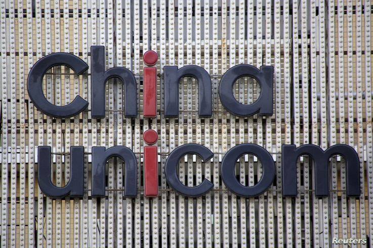 FILE - China Unicom's company logo is seen at its branch office in Beijing, China, Apr. 21, 2016.