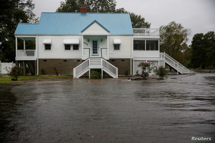 Water from the Neuse River closes in on a house as Hurricane Florence begins to make its destructive presence known in New Bern, N.C., Sept. 13, 2018.