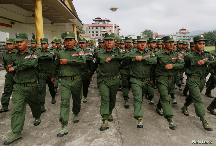 FILE - United Wa State Army (UWSA) soldiers march during a display for the media in Pansang, Wa territory in north east Myanmar, Oct. 4, 2016.