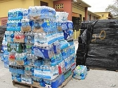 Palettes of bottled water destined for Haiti are neatly placed in Notre Dame d'Haiti church's  parking lot, 3 Mar 2010