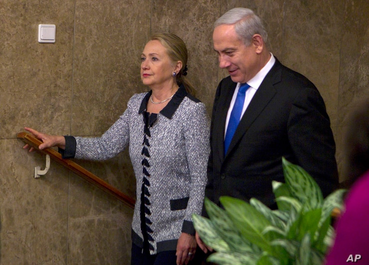 FILE - Israel's Prime Minister Benjamin Netanyahu walks with U.S. Secretary of State Hillary Rodham Clinton upon her arrival to their meeting in Jerusalem,  Nov. 20, 2012.