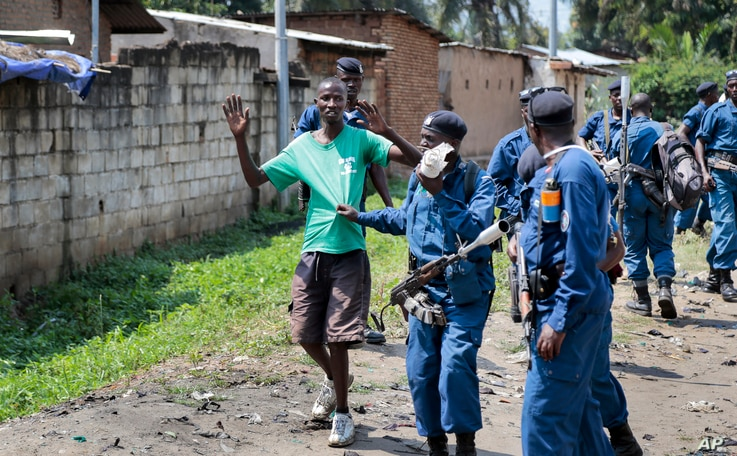 Burundian police arrest a demonstrator during clashes with security forces in the Cibitoke district of the capital Bujumbura, Burundi, May 29, 2015.