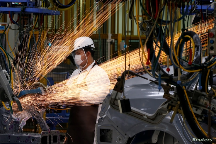 A man works in the automobile production line of the new Honda plant in Prachinburi, Thailand, May 12, 2016.