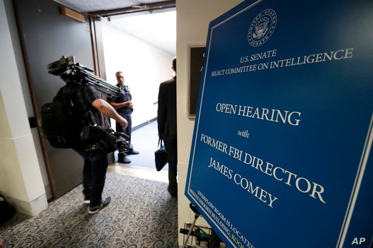 Media enter the hearing for former FBI Director James Comey's appearance before the Senate Intelligence Committee, on Capitol Hill, June 8, 2017, in Washington.