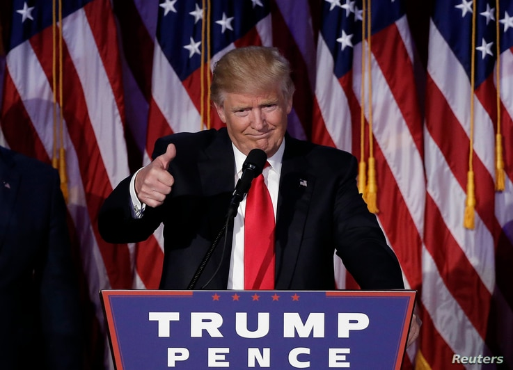 U.S. President-elect Donald Trump greets supporters during his election night rally in Manhattan, New York, U.S., Nov. 9, 2016.