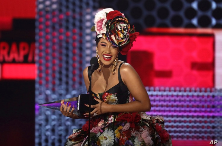 Cardi B accepts the award for favorite rap/hip-hop artist at the American Music Awards on Tuesday, Oct. 9, 2018, at the Microsoft Theater in Los Angeles.