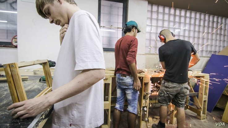 A workshop in the basement of the Khora center helps efforts to continue the expansion of the facilities, in the Exarchia district in Athens, Greece, Oct. 26, 2016.