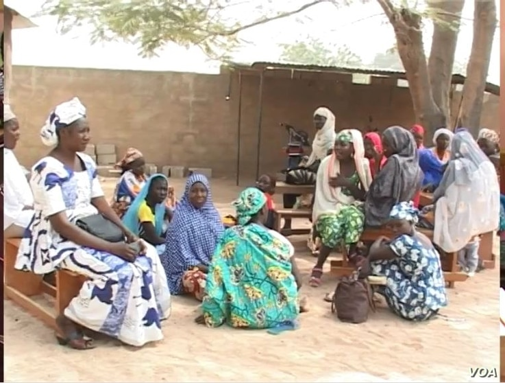 Women and girls gather at a women's center opened by Aissa Doumara Ngatansou, in Maroua, March 6, 2019.