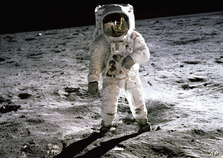 """July 1969: Astronaut Buzz Aldrin walks on the surface of the Moon near the leg of the Lunar Module (LM) """"Eagle"""" during the Apollo 11 extravehicular activity (EVA). Astronaut Neil Armstrong, commander, took this photograph with a 70mm lunar surface ca"""