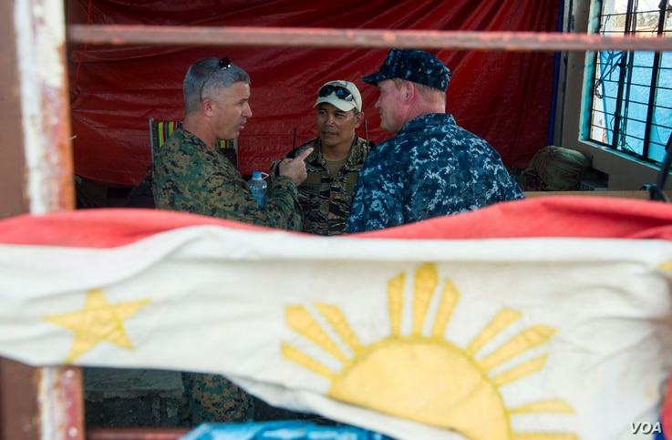 From left to right: U.S. Marine Corps Brig. Gen. Paul Kennedy, commanding general, 3d Marine Expeditionary Brigade; Philippine navy Capt. Roy Vincent Trinidad, officer in charge, Tacloban airfield; and U.S. Navy Rear Adm. Mark Montgomery, commander, ...