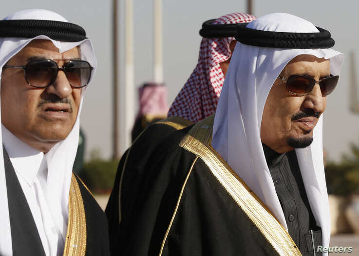 Saudi Arabia's Crown Prince Mohammed bin Nayef (L) seen here with his uncle King Salman (R)  in Riyadh, January 27, 2015. King Salman has designated Prince Mohammed to attend this week's GCC summit at Camp David. REUTERS/Jim Bourg