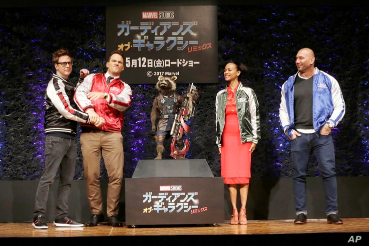 """Director James Gunn (from left) actors Chris Pratt, Zoe Saldana and Dave Bautista pose for photographers during a media conference of """"Guardians of the Galaxy Vol. 2"""" in Tokyo, April 11, 2017."""