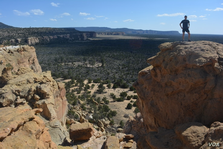 National parks traveler Mikah Meyer says he felt like a child scrambling among the boulders at El Malpais National Monument.