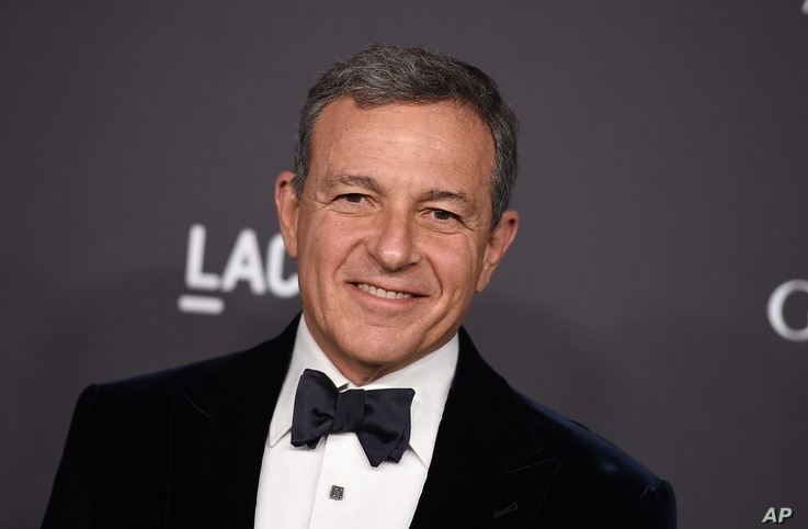 FILE - Disney CEO Bob Iger, pictured in October 2016 at a Los Angeles gala, has served in an advisory role for President Barack Obama and will do the same for Donald Trump when he assumes the presidency.