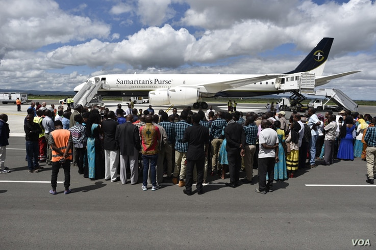 Well-wishers came out to see the three children before they left Tanzania for the U.S. aboard the Samaritan's Purse DC-8. (Photos courtesy of Samaritan's Purse)
