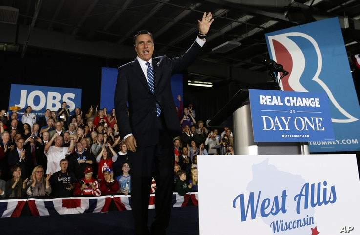 Republican presidential candidate, former Massachusetts Gov. Mitt Romney waves to supporters as he arrives for a campaign stop at the Wisconsin Products Pavilion at State Fair Park in West Allis, Wis., November 2, 2012.