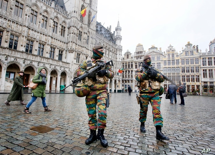 Belgium police officers patrol the Grand Place in central Brussels, Belgium, Nov. 24, 2015. The lockdown has closed the capital's subways and schools. Officials have recommended that popular shopping districts be shuttered.