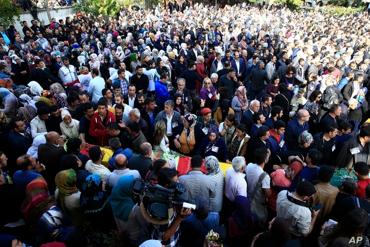 People attend the funerals of victims on Saturday's bombing attacks, in Istanbul, Oct. 12, 2015.