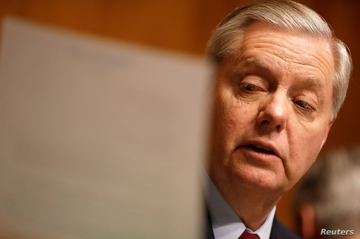 FILE - Chairman Sen. Lindsay Graham (R-SC) reads a letter on Capitol Hill in Washington, March 15, 2017.