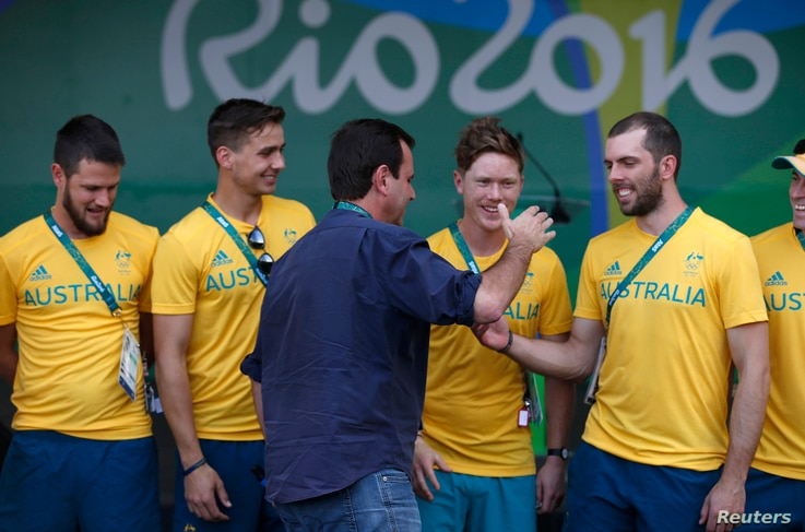 Rio de Janeiro Mayor Eduardo Paes greets Australian athletes during a welcome ceremony he arranged for the delegation at the Olympic village in Rio de Janeiro, Brazil, July 27, 2016.