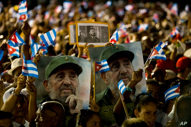People wait for the start of a memorial honoring the late Fidel Castro at Plaza Antonio Maceo in Santiago, Cuba, Dec. 3, 2016.