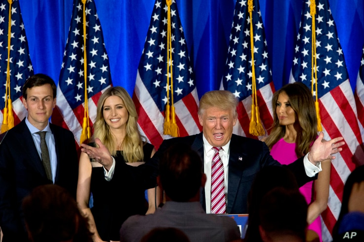 Then Republican presidential candidate Donald Trump is joined by his wife Melania, daughter Ivanka and son-in-law Jared Kushner as he speaks during a news conference at the Trump National Golf Club Westchester, June 7, 2016 in New York.