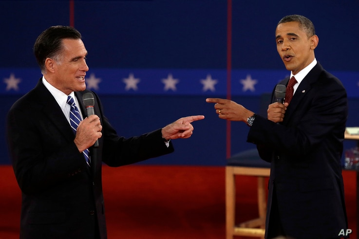 FILE - In this Oct. 16, 2012 file photo, Republican presidential nominee Mitt Romney, left, and President Barack Obama spar during a presidential debate at Hofstra University in Hempstead, N.Y.