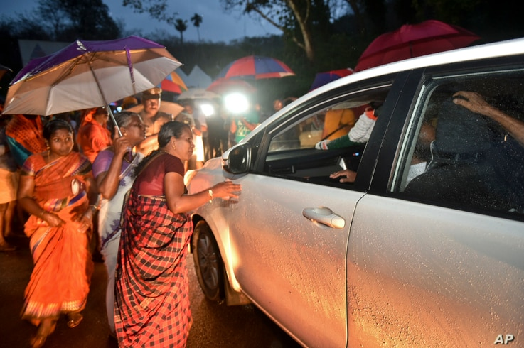 Hindu women favoring barring women of menstruating age from entering the Sabarimala temple scan vehicles at Nilackal, a base camp on way to the mountain shrine in Kerala, India, Oct. 16, 2018.