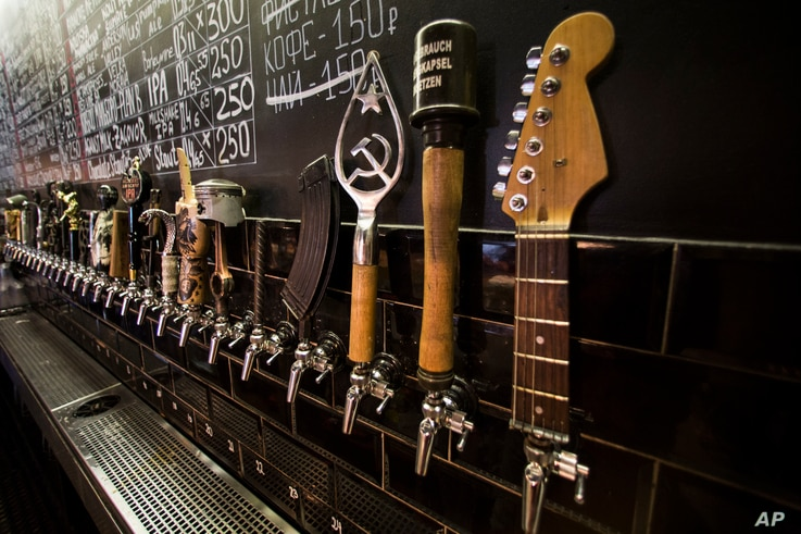 In this July 21, 2017 photo, a craft beer wall of taps is seen at the RULE Taproom pub in Moscow, Russia.