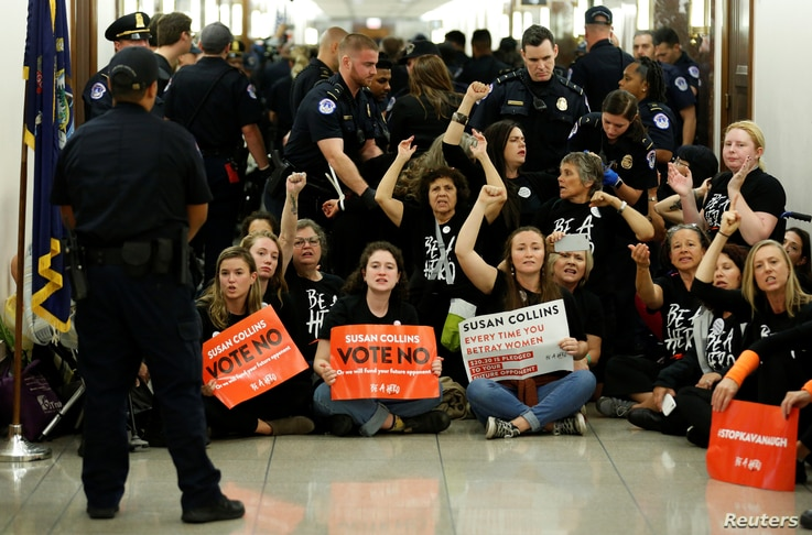 Demonstrators chant before being arrested as they protest against U.S. Supreme Court nominee Brett Kavanaugh in front of the office of Senator Susan Collins (R-ME) on Capitol Hill in Washington, U.S., September 24, 2018.