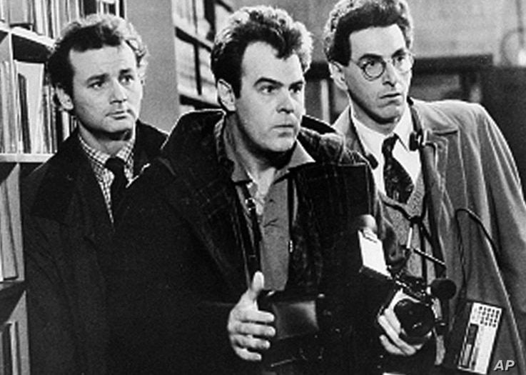 """FILE - In an undated file photo, Bill Murray, Dan Aykroyd, center, and Harold Ramis, right, appear in a scene from the 1984 movie """"Ghostbusters""""."""