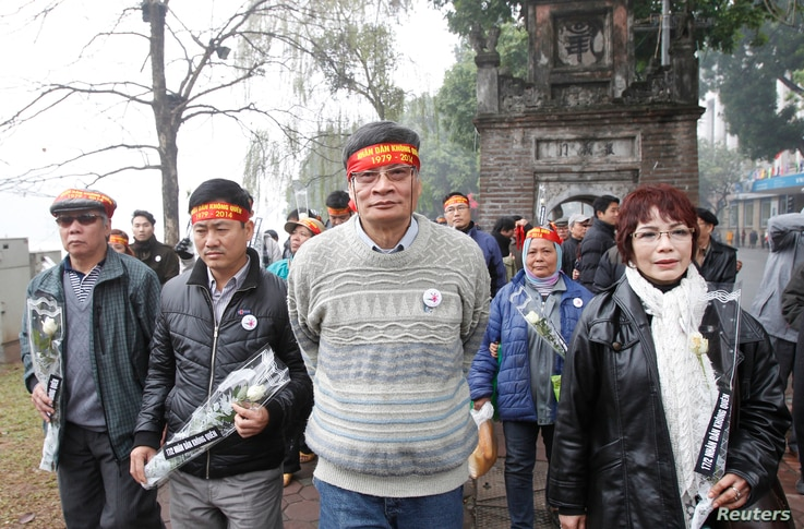 FILE - Anti-China protester Nguyen Quang A marches during a gathering to mark the 35th anniversary of the border war between Vietnam and China, along Hoan Kiem lake in Hanoi, Feb. 16, 2014.