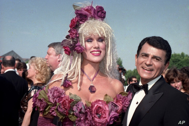 FILE - Casey Kasem, along with his wife, Jean Kasem, arrives at the Emmy Awards in Los Angeles. Kasem, the smooth-voiced radio broadcaster who became the king of the top 40 countdown, died at age 82, June 15, 2014.